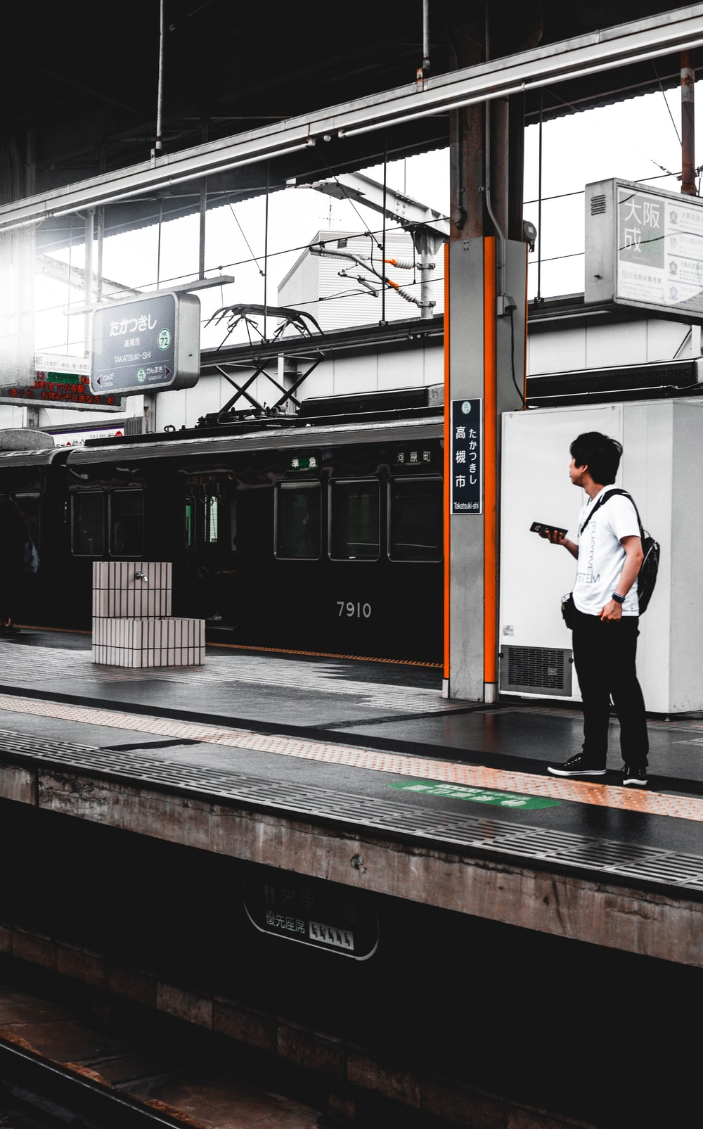 man standing on a train station