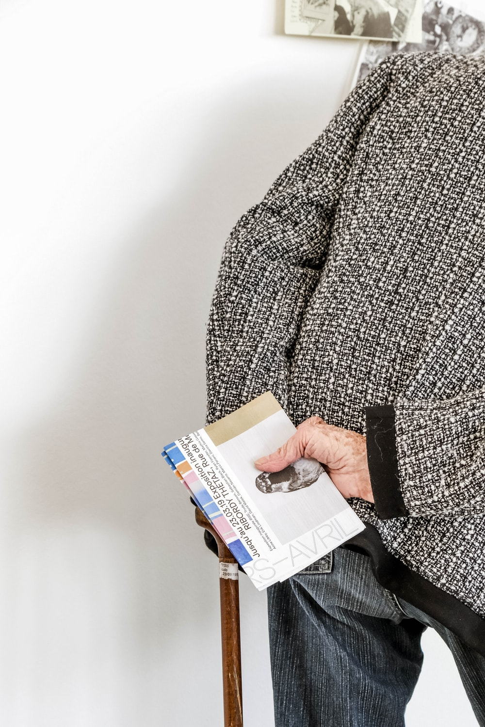 person holding brochure