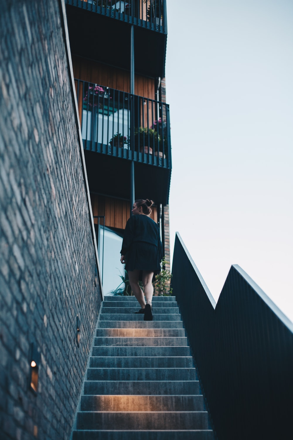woman walking and going up on building