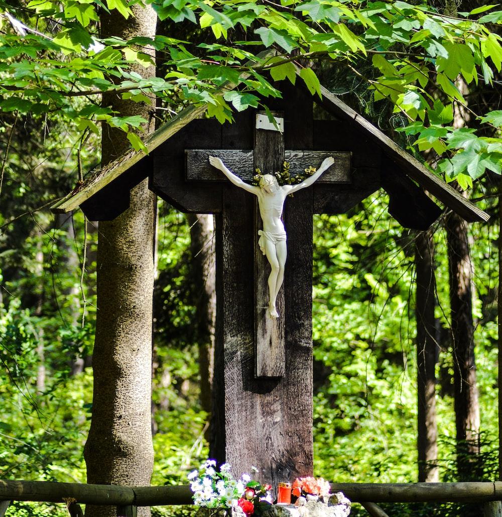 crucifix decor near trees