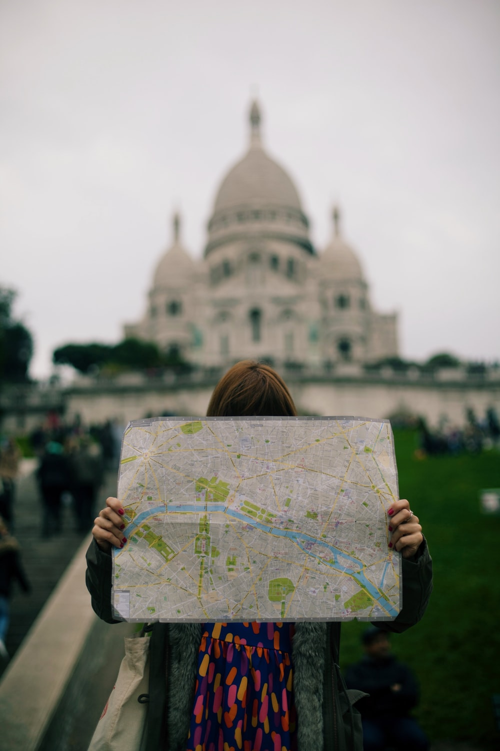 person holding map during daytime