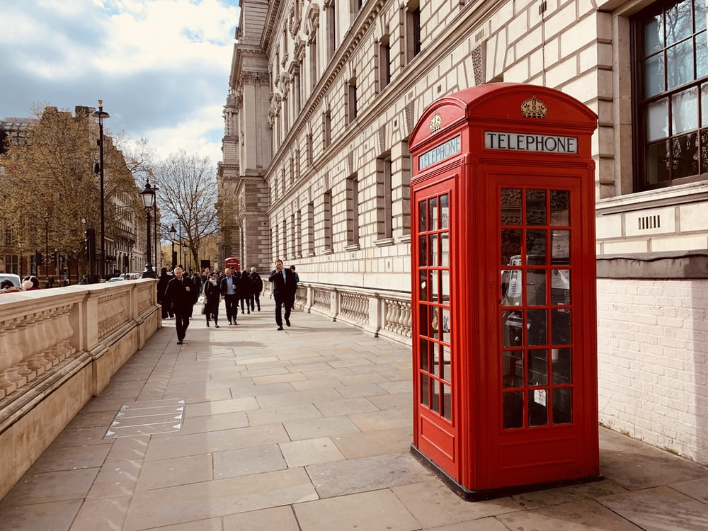 red telephone booth near building