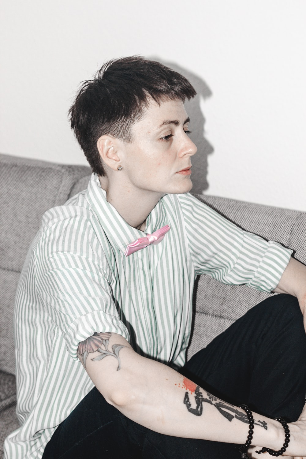 person sitting on a sofa facing to the side