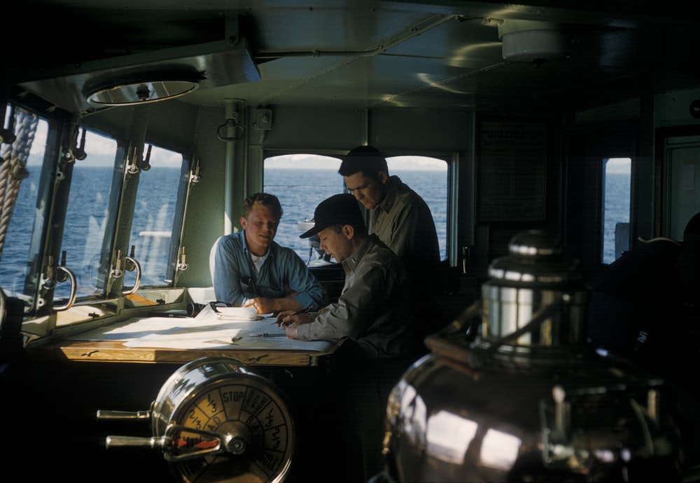 three men navigating