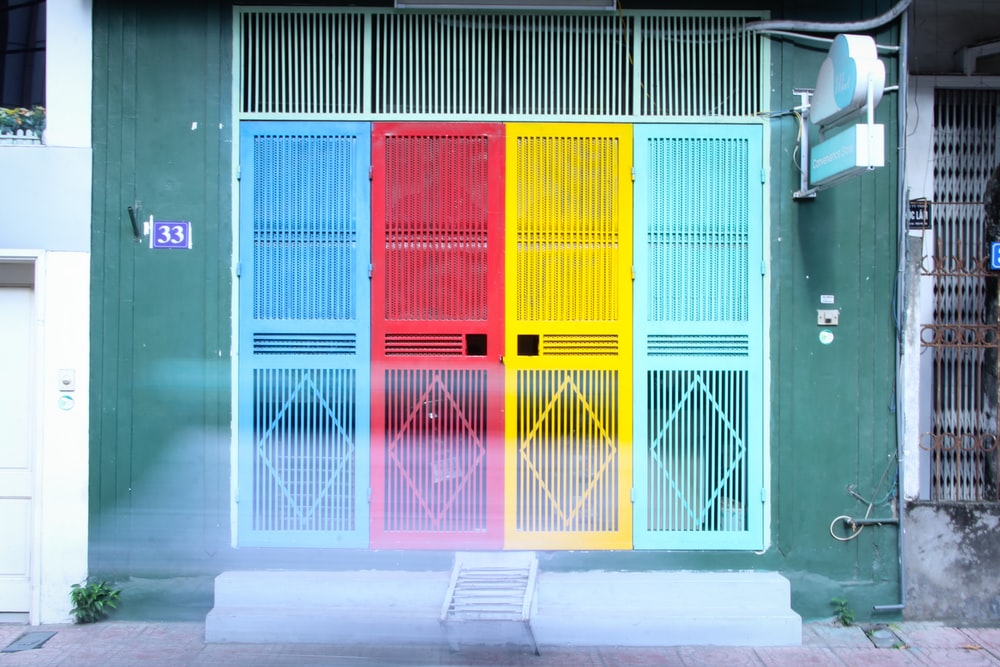 four closed assorted-color doors