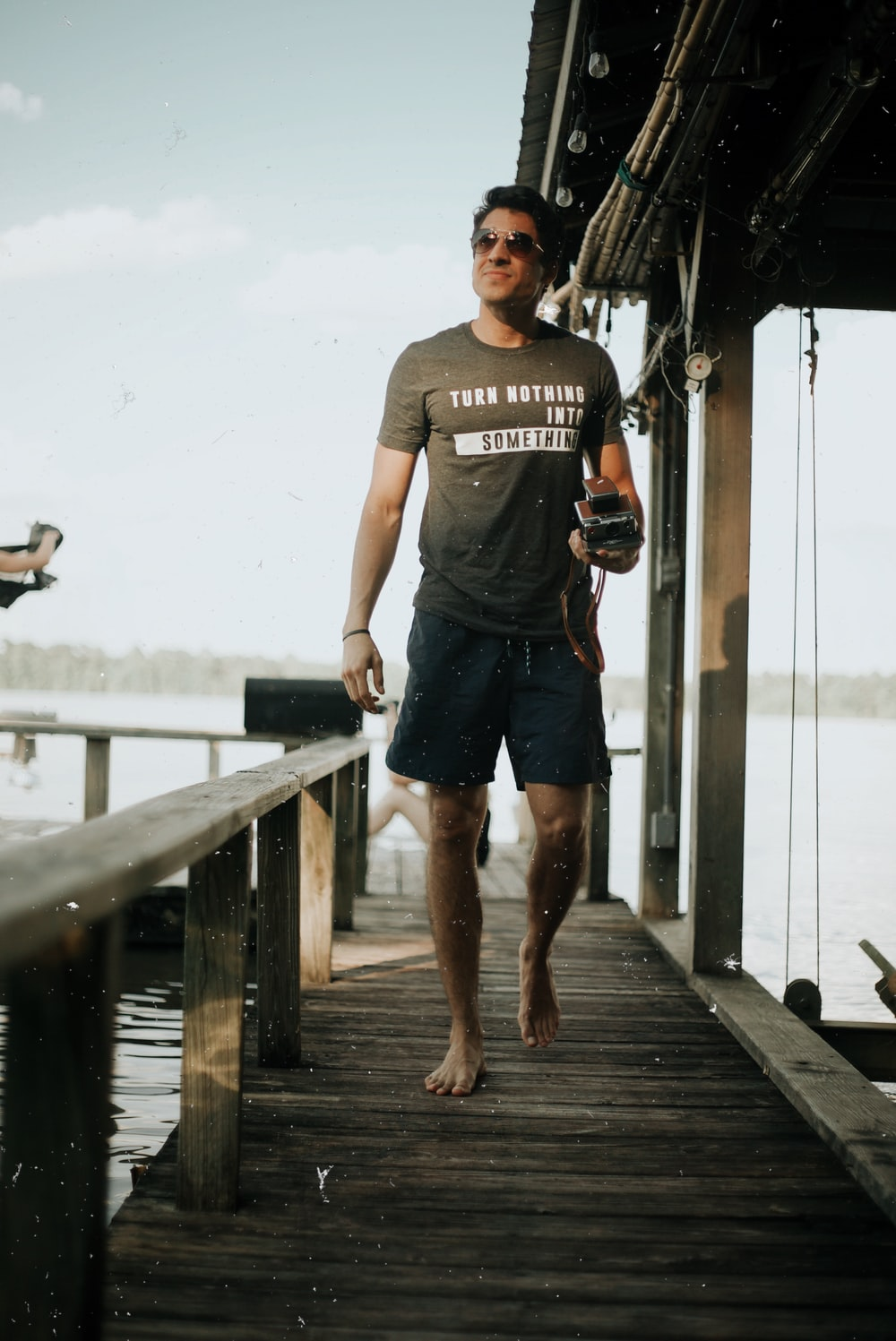 man walking on boat port
