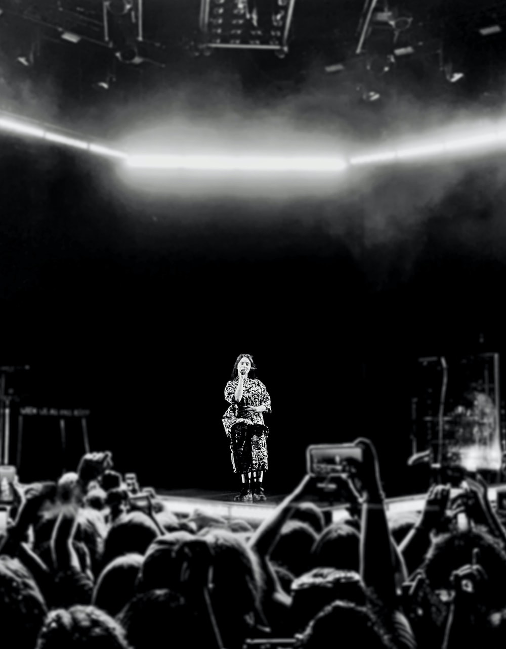 greyscale photography of person performing on stage