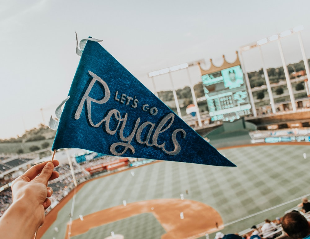 blue and white Lets Go Royal pennant