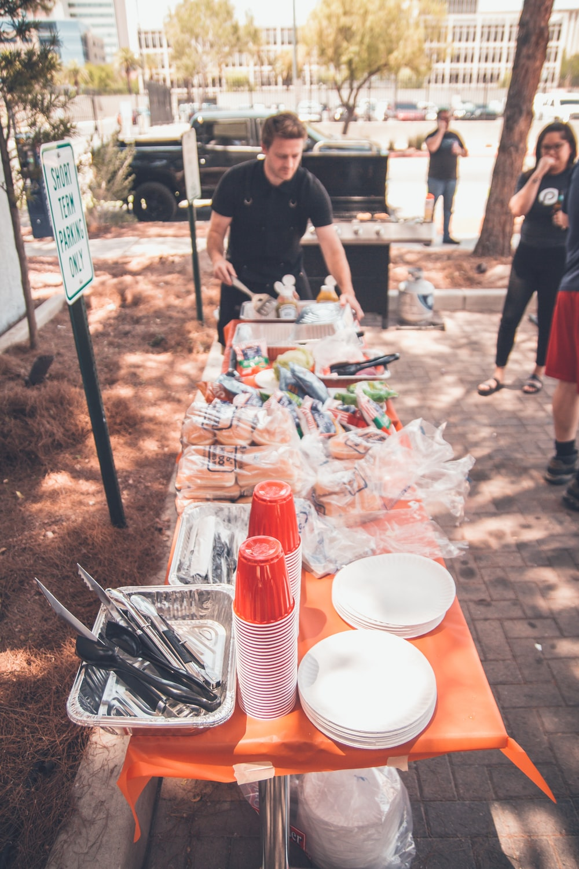 people preparing food outside during daytime