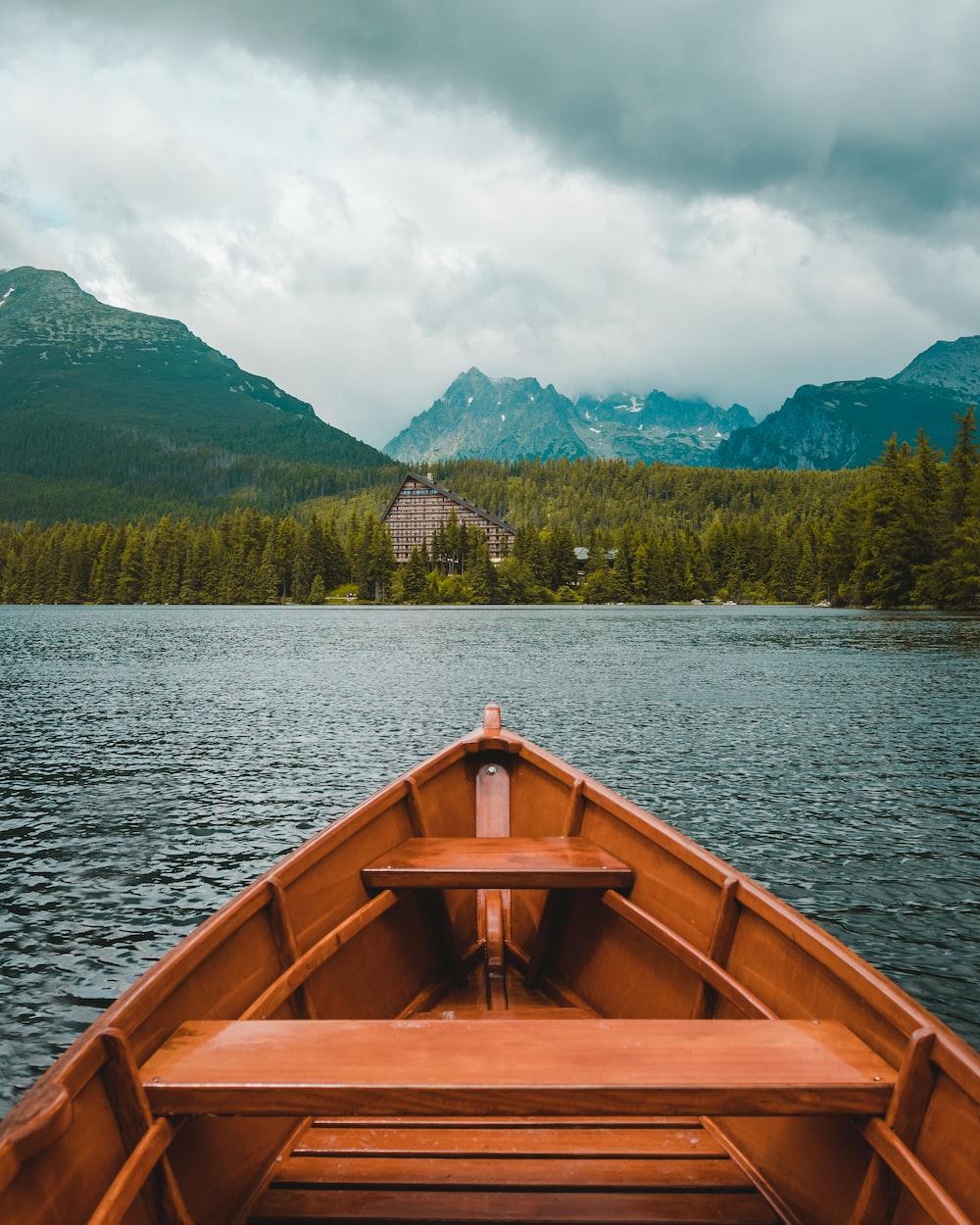 brown canoe on water