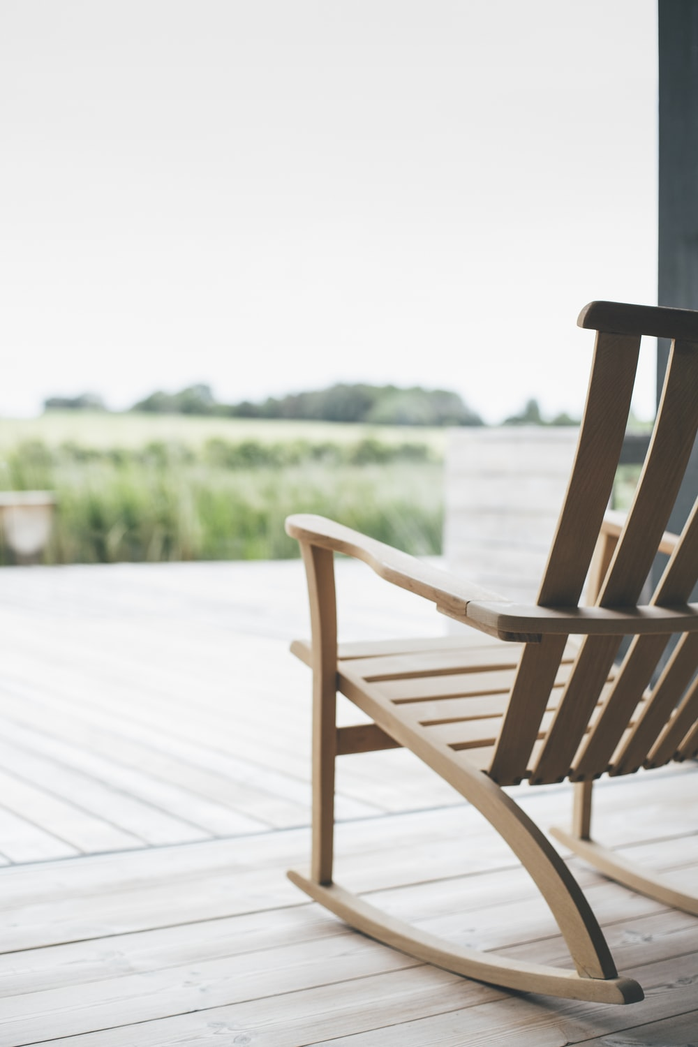 selective focus photography of rocking chair