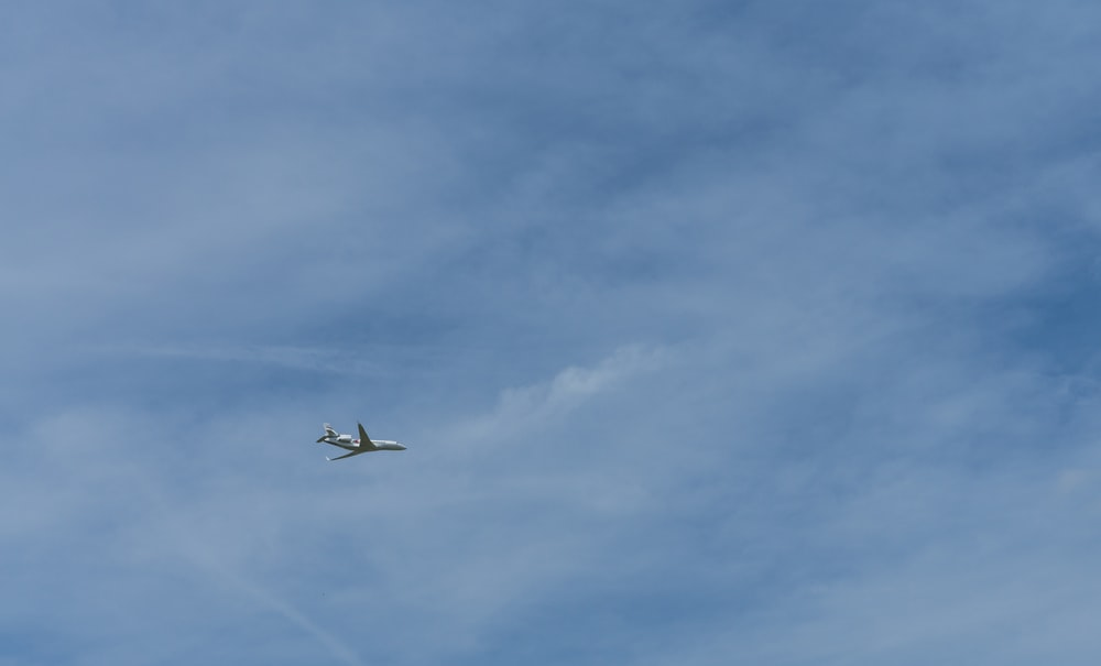 plane flying during daytime