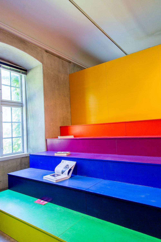 multicolored wooden bleachers inside room beside window