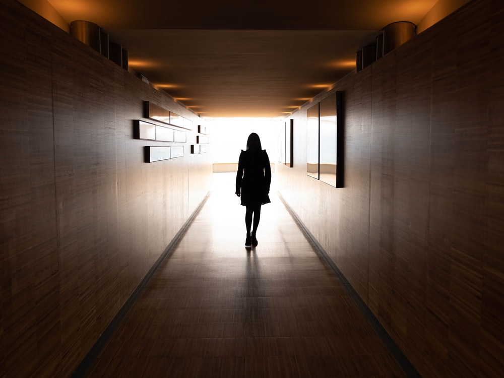 silhouette of woman near wall