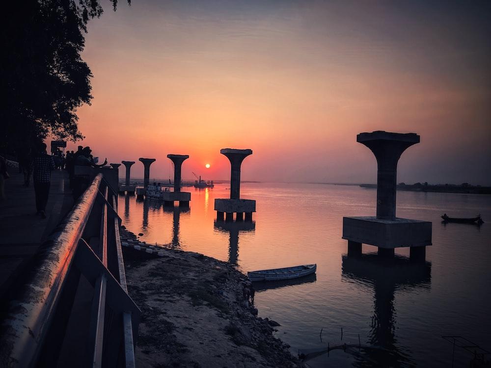 grey concrete bridge pillars at the bay
