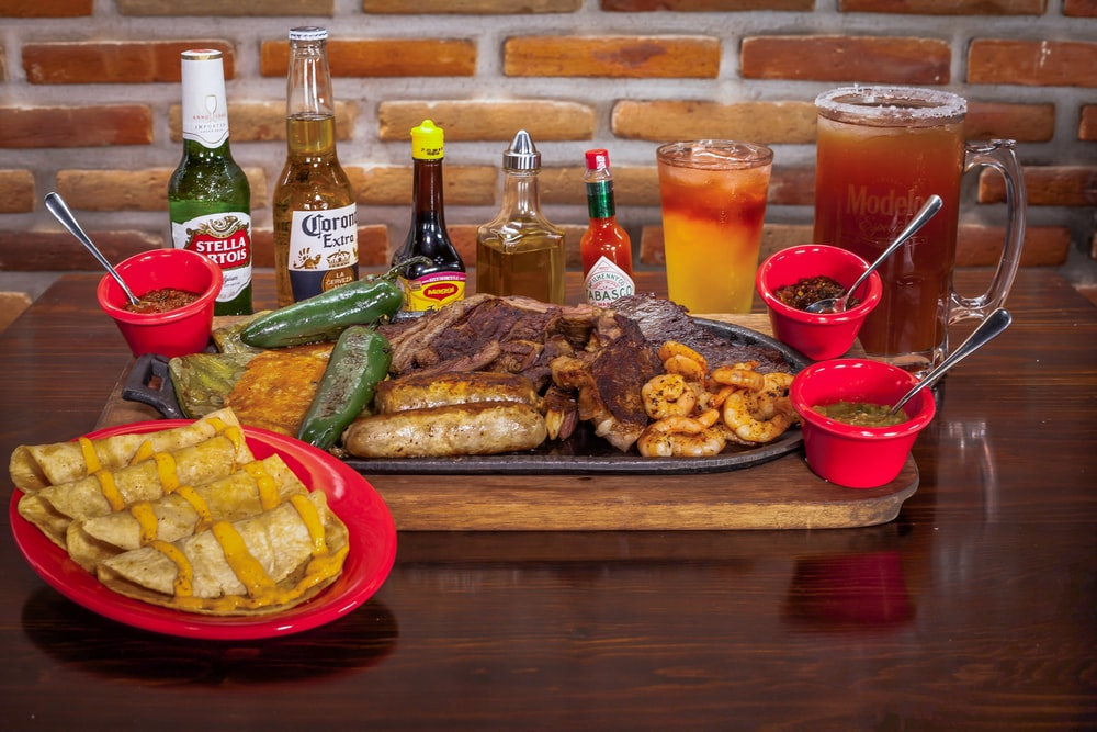 grilled food with bottles and beverages