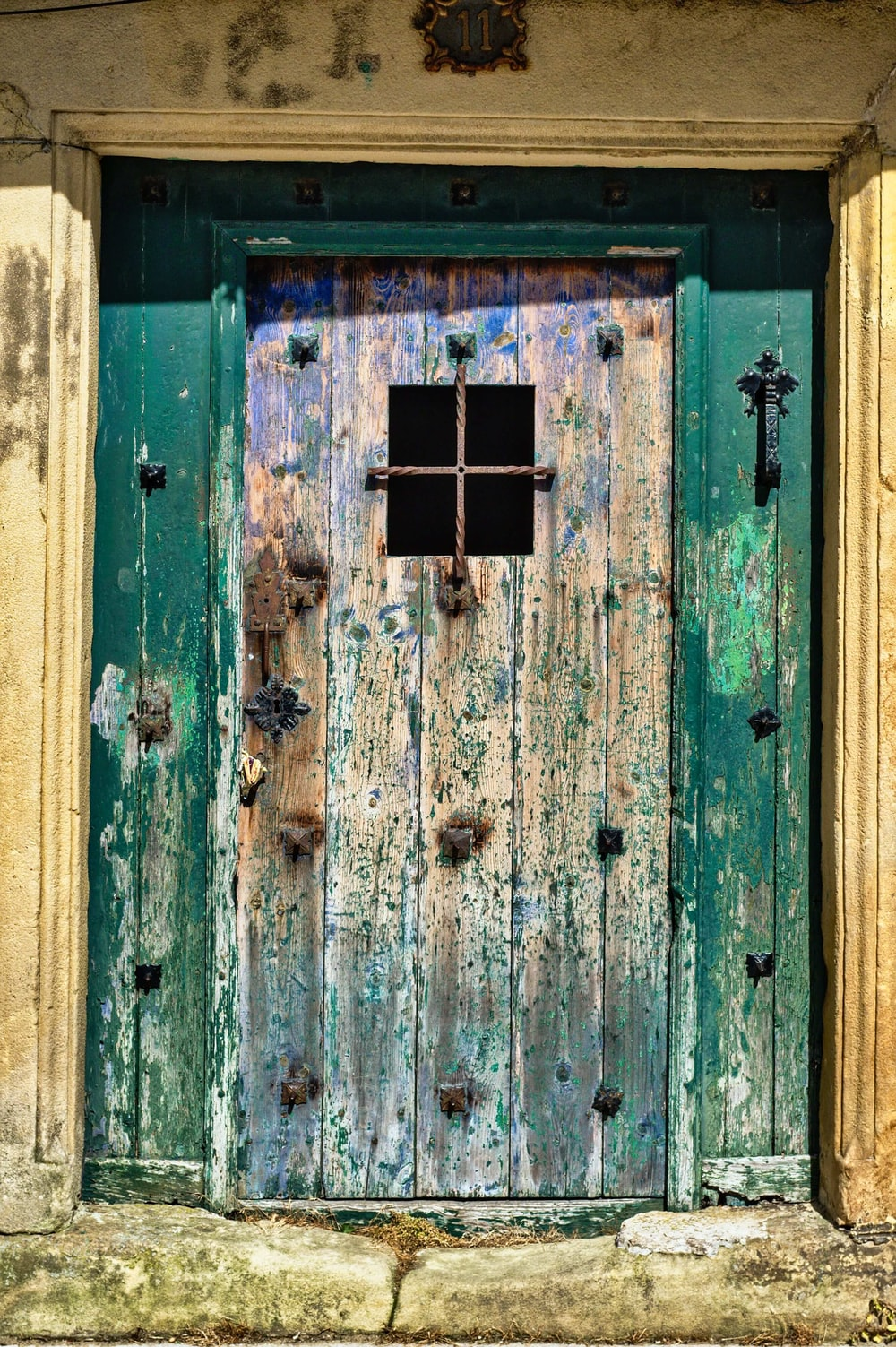 close photography of closed wooden door