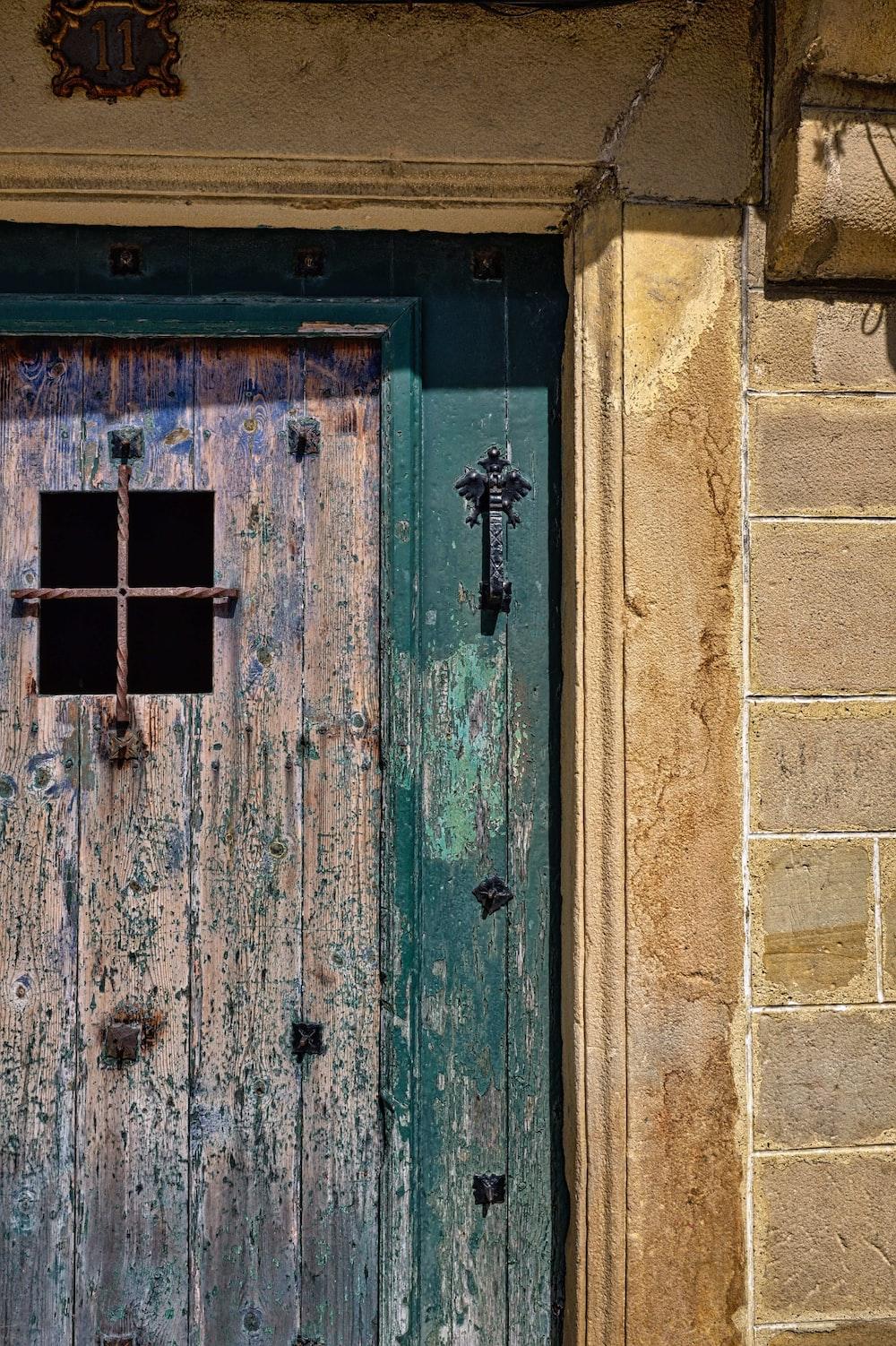 closed green and brown wooden door panel