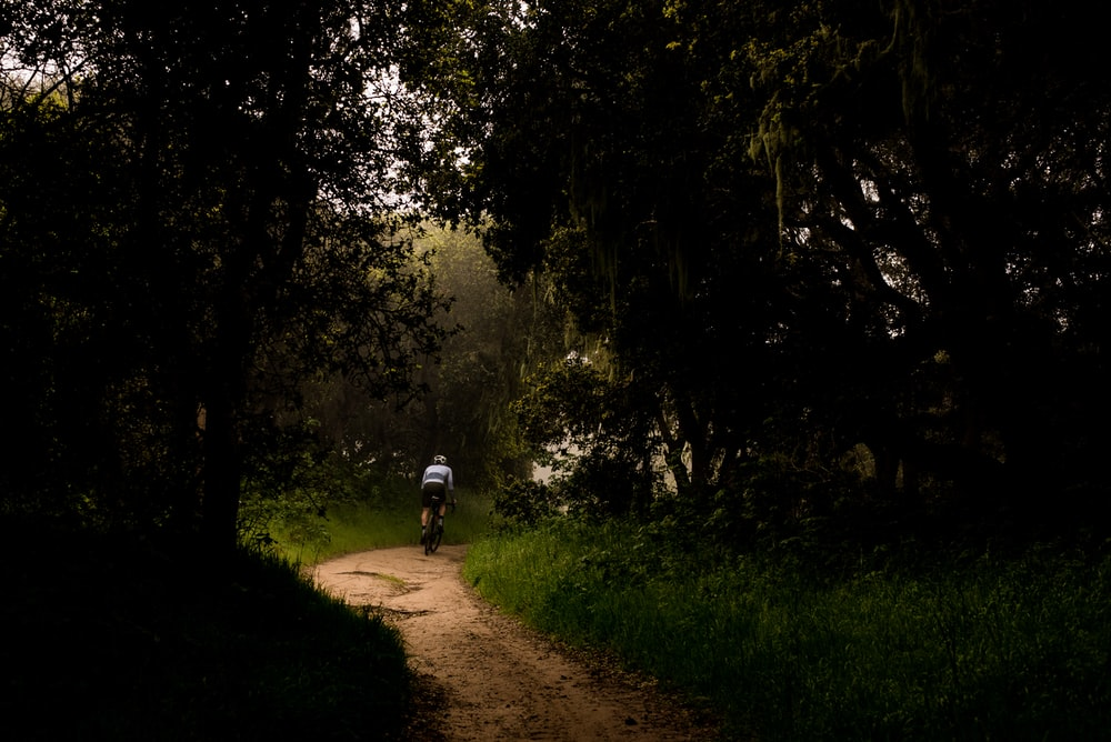 man riding bicycle photography