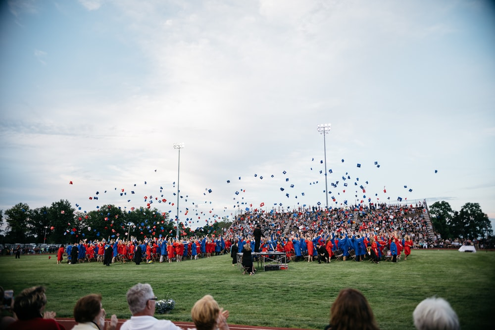 group of students throwing their mortar boards