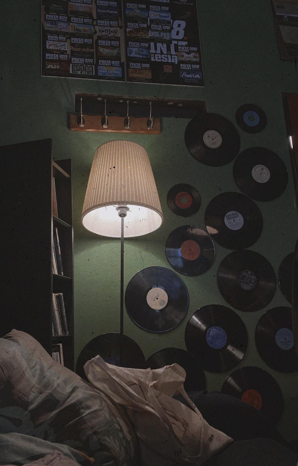 black vinyl albums on a green wall