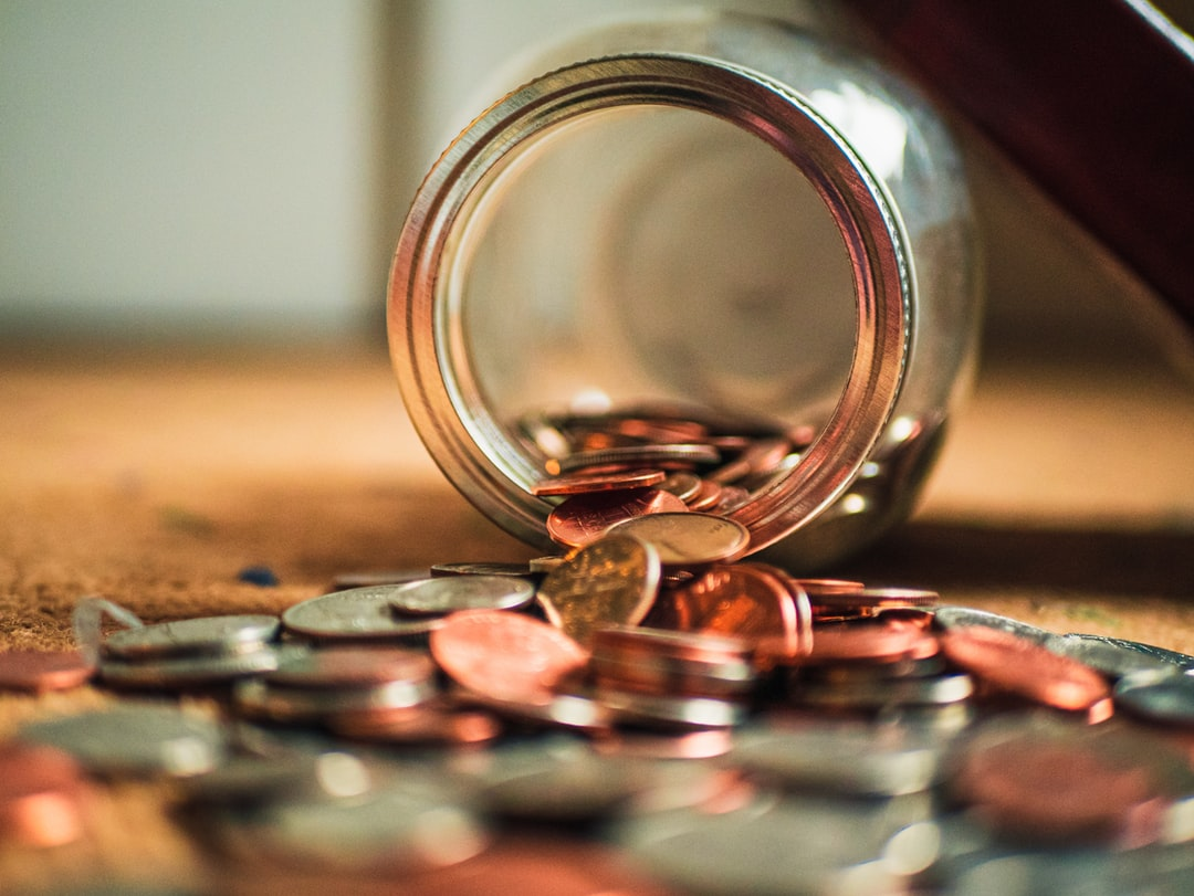 A jar of coins spilling out.
