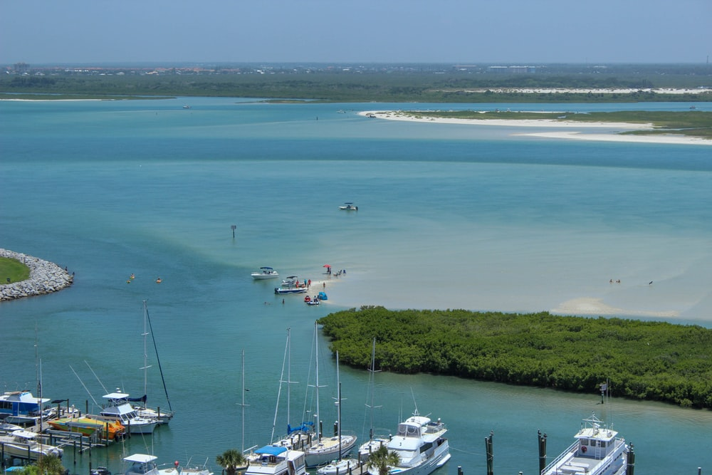 yacht parked near island