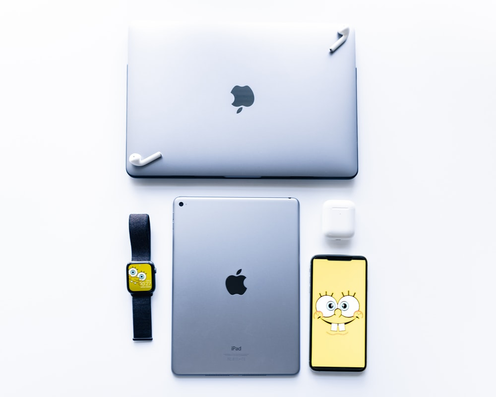 silver Apple Macbook Air, iPad and iPhone