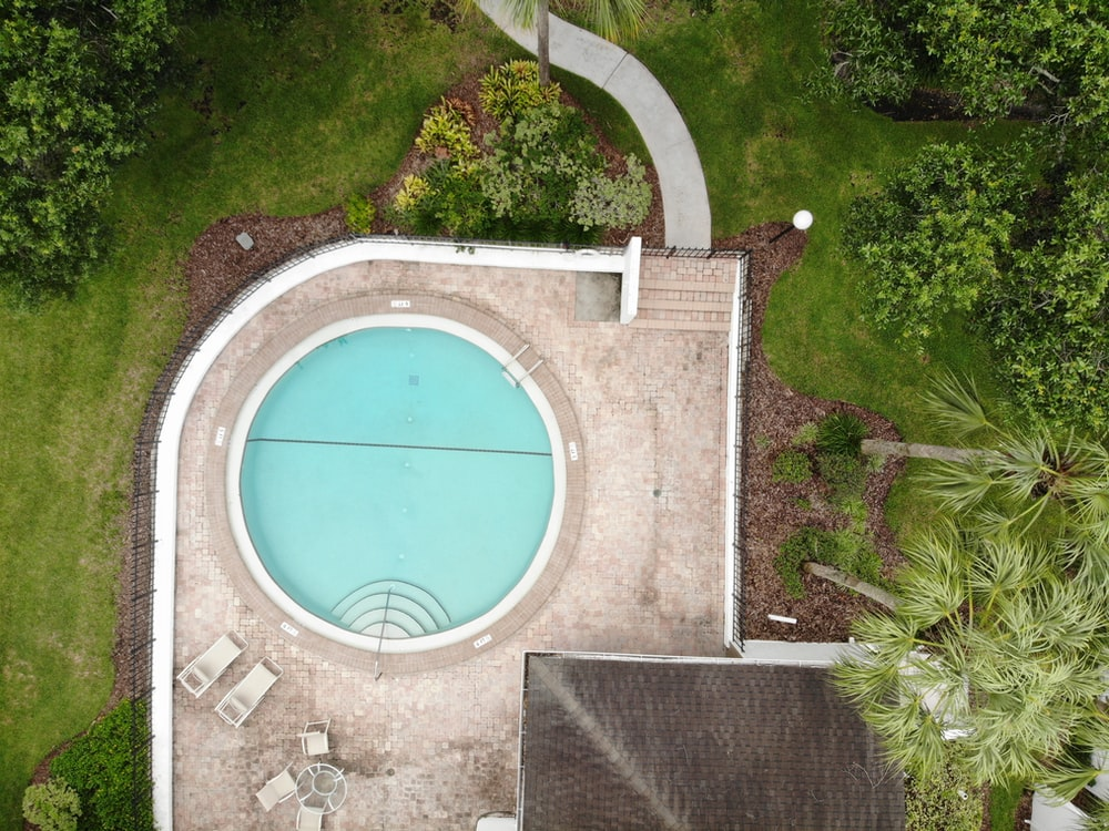 aerial view of house with round pool