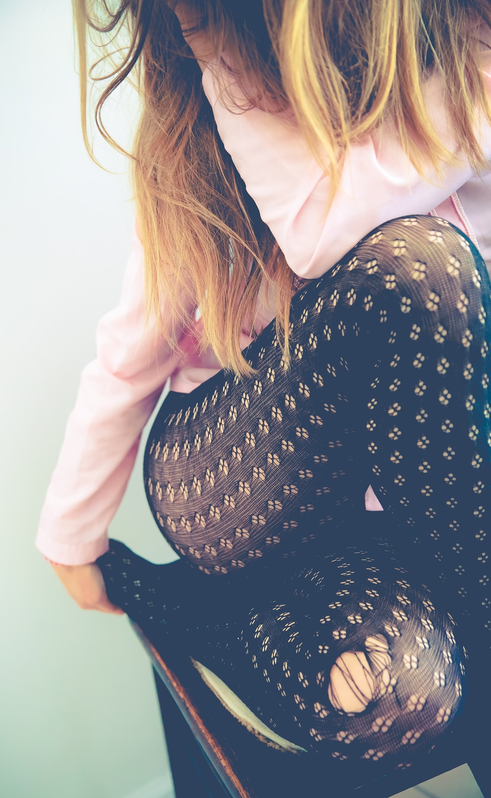 woman in black distressed leggings
