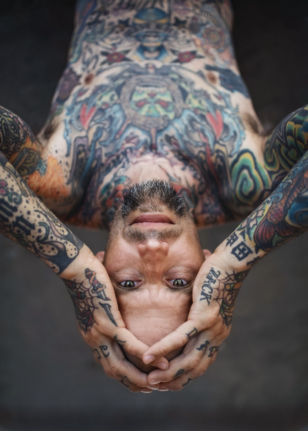 man with arms and body tattoos