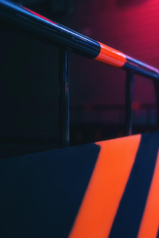 black and orange metal rail