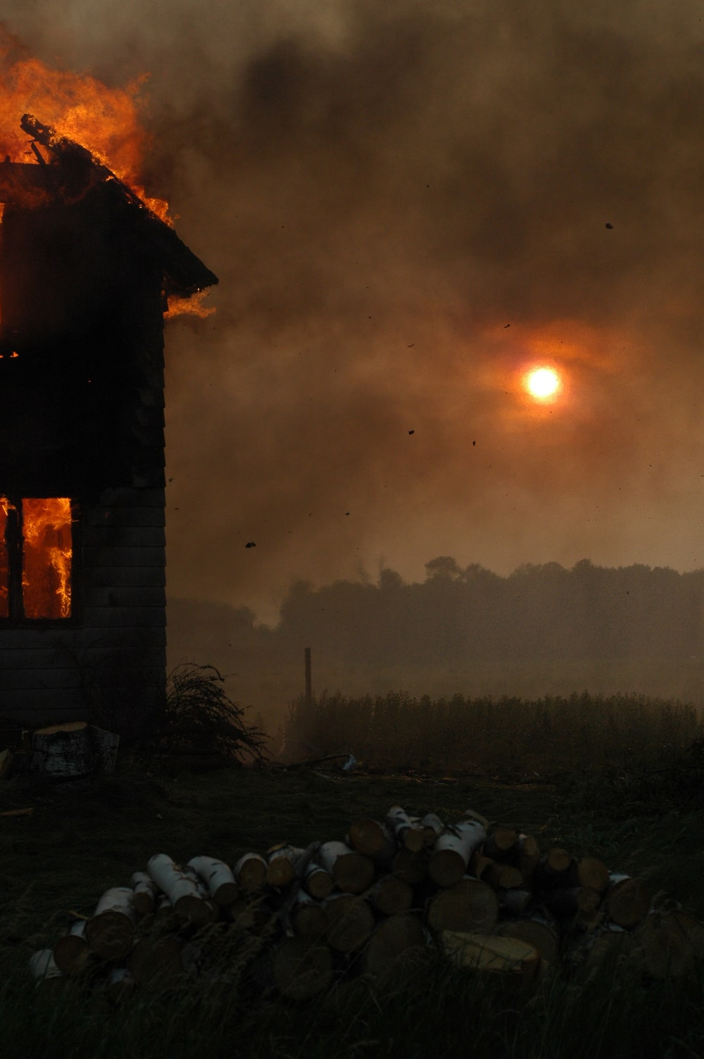 time lapse photography of a burning building during golden hour