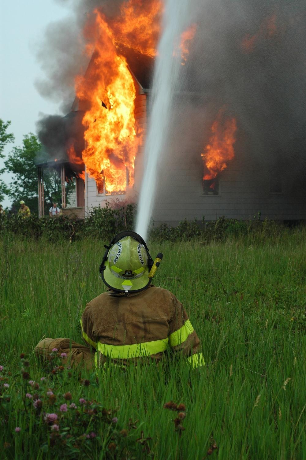 man near flaming house