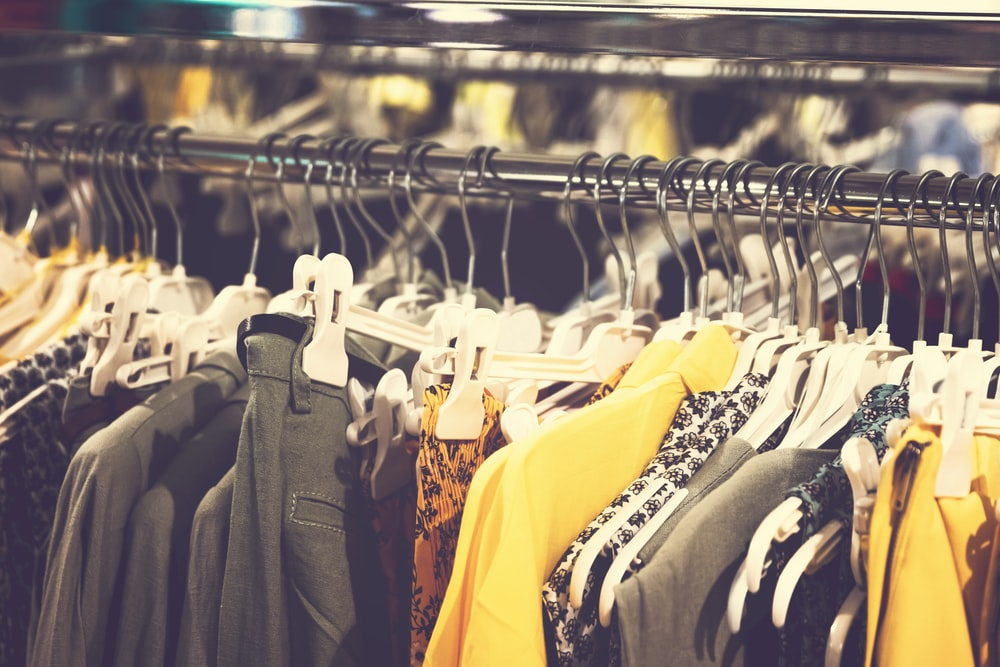 men's clothes displayed on a rack