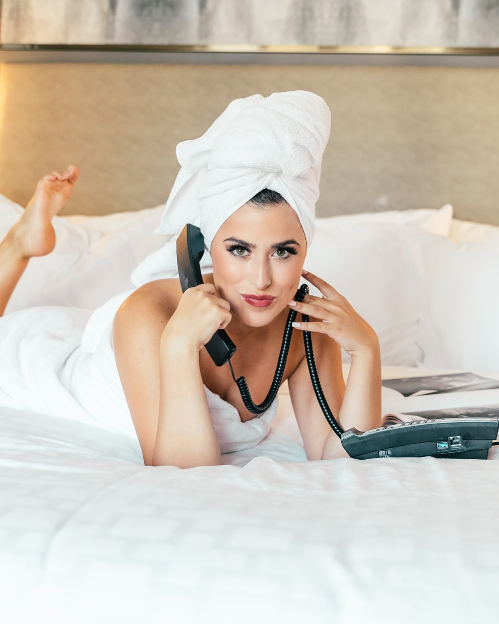 woman holding corded home phone