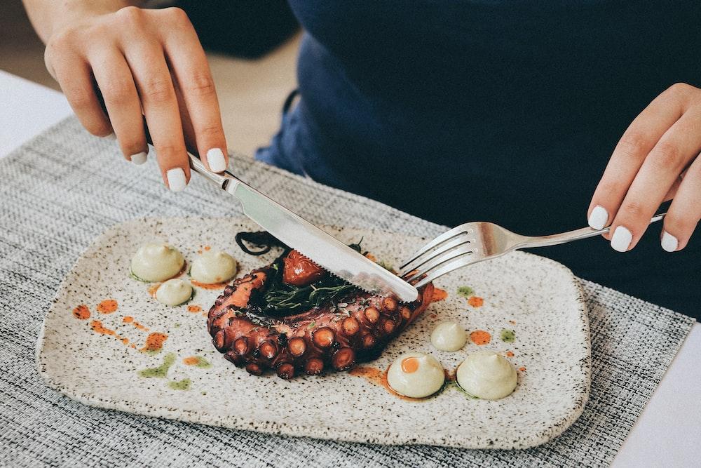 woman eating tentacles food