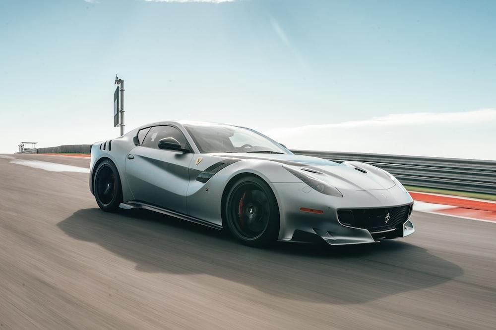 silver Ferrari supercar in race track