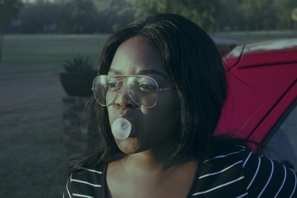 selective focus photography of woman wearing eyeglasses