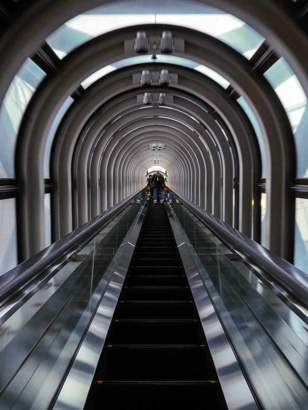person standing on escalator
