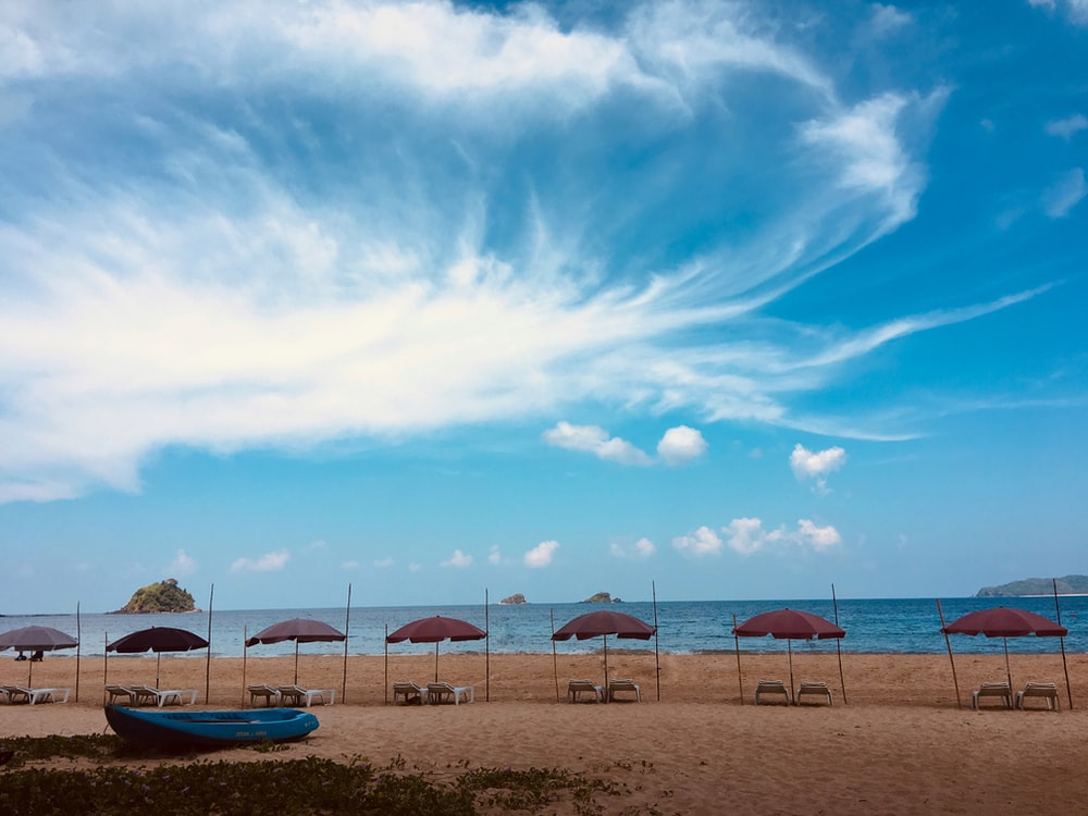 blue canoe boat seashore scenery
