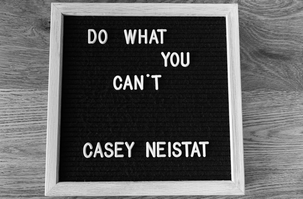 white wooden framed Do What You Can't by Casey Neistat quote