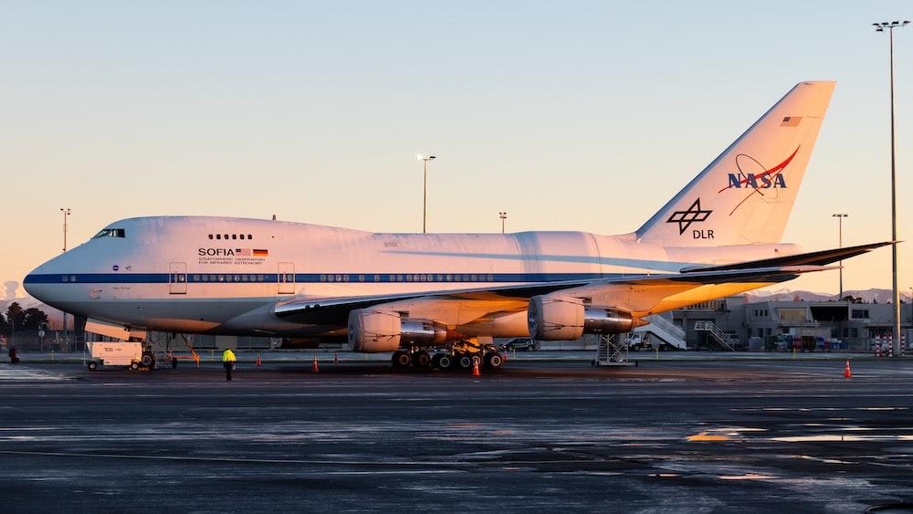 white NASA airbus on runway