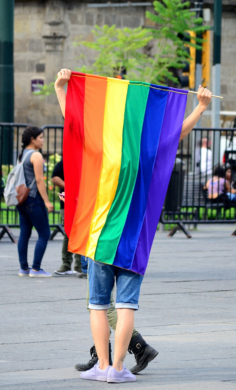 person holding multicolored flag