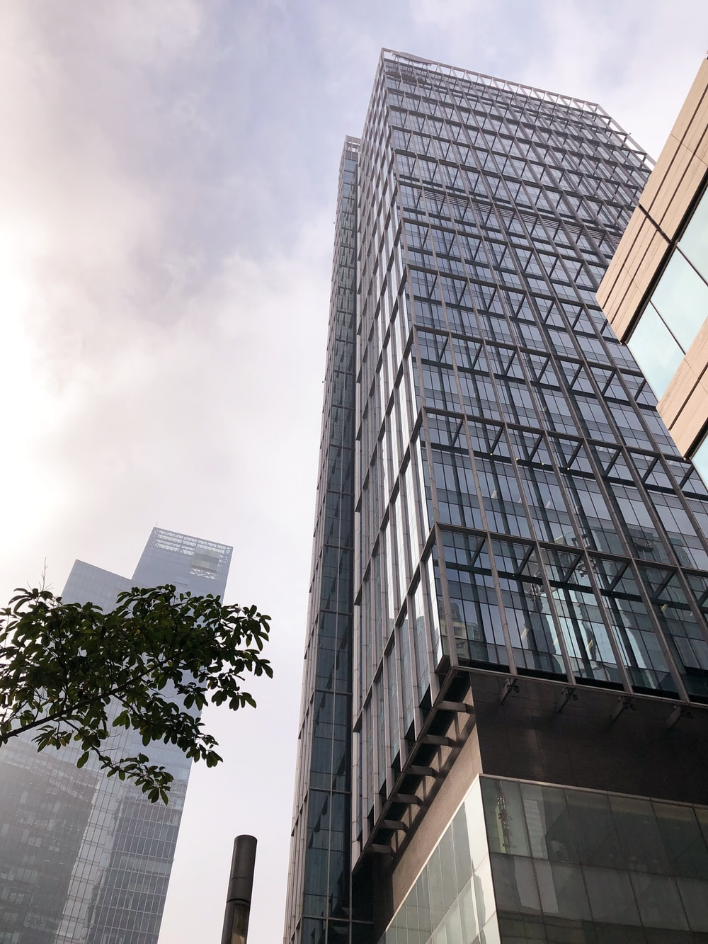 low-angle photography of gray glass high-rise building