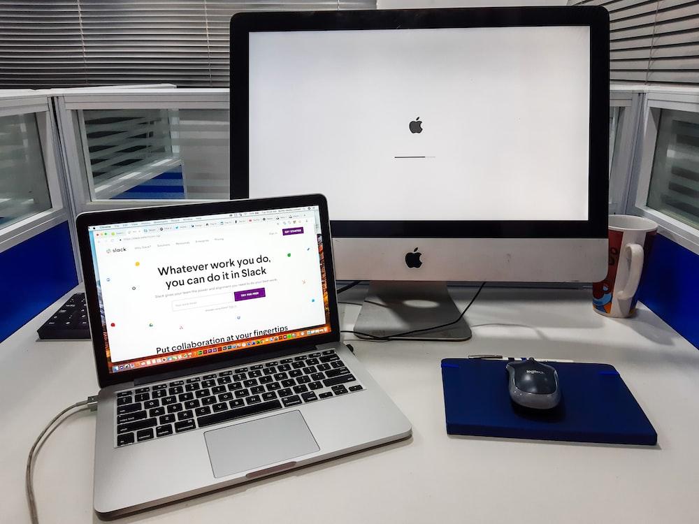silver iMac near space gray MacBook Pro