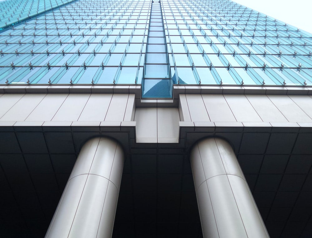 bottom view photography of curtain wall building