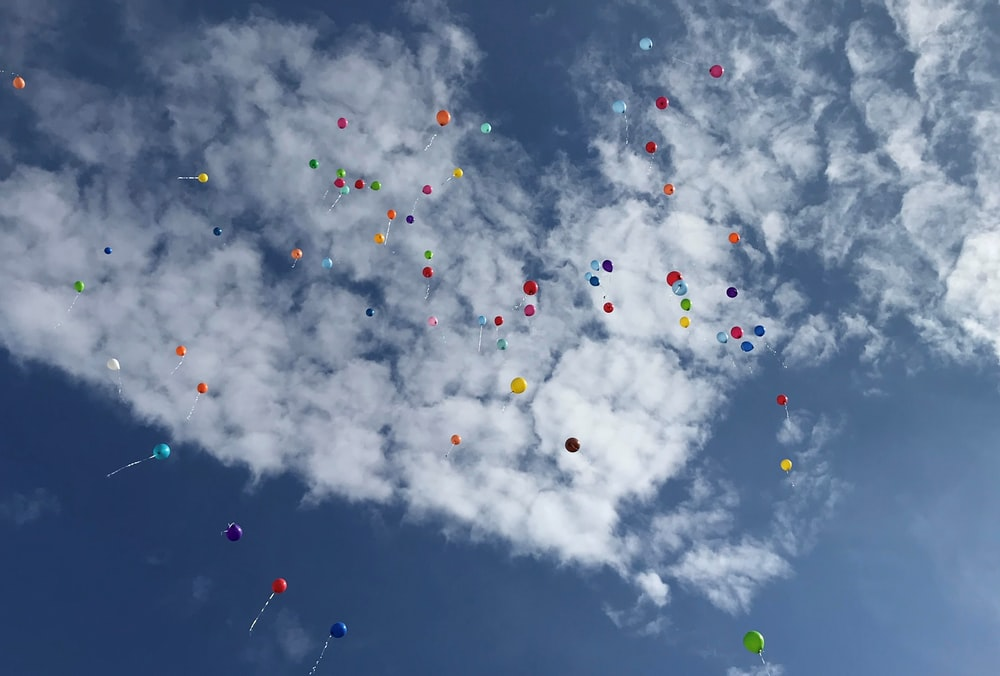 assorted balloons in the sky