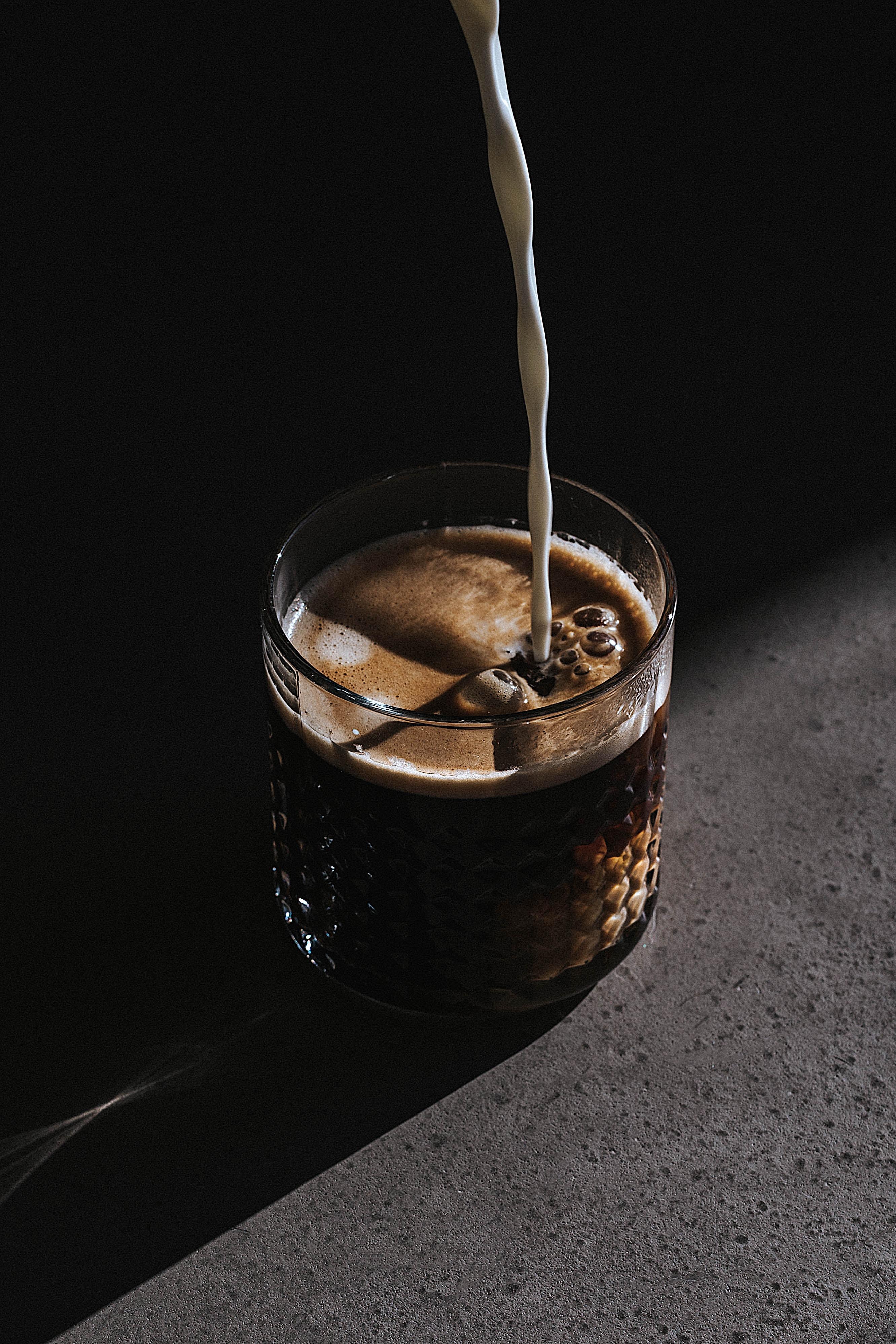 dark glass of creamy coffee