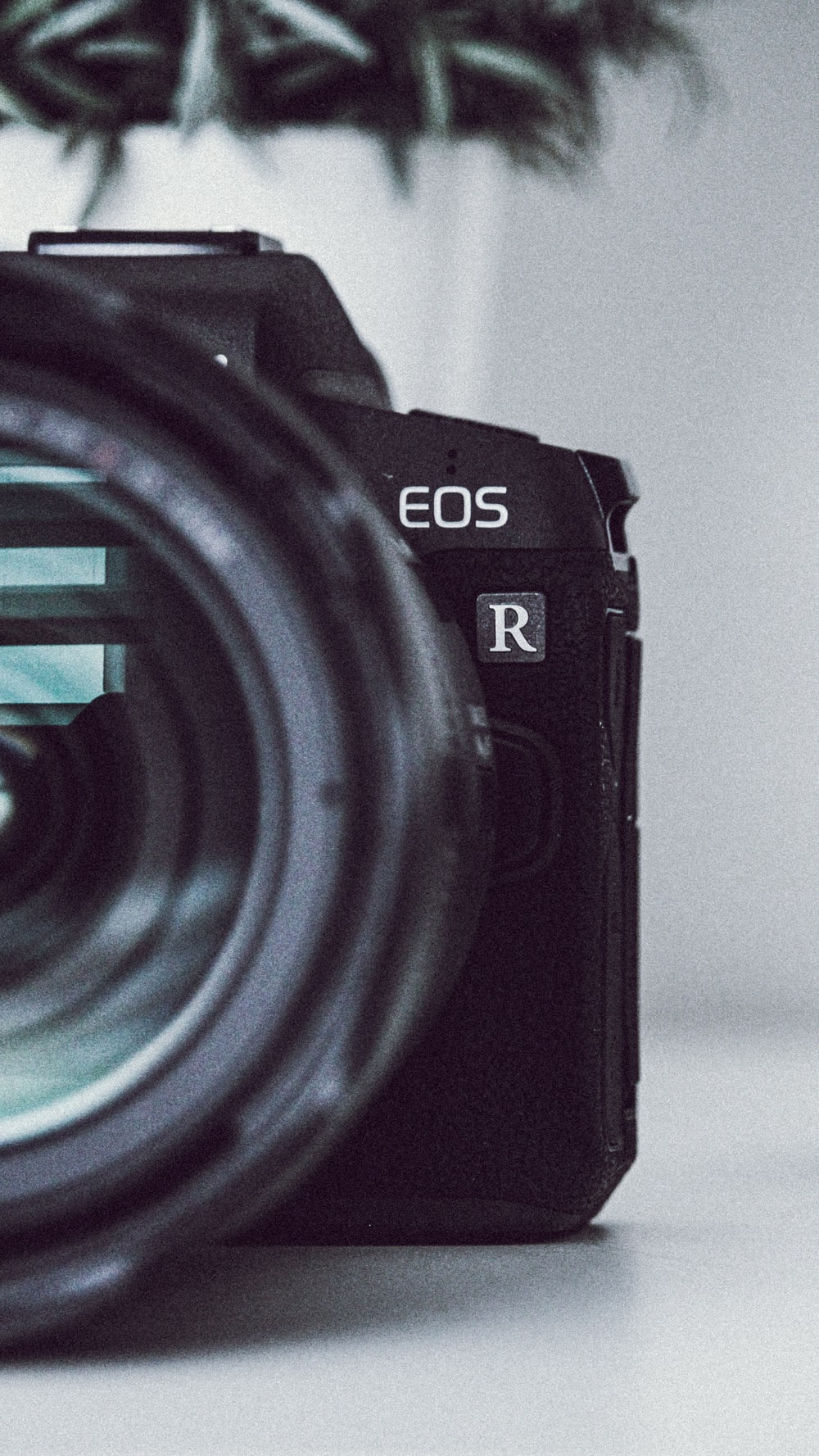 black Canon EOS R DSLR camera